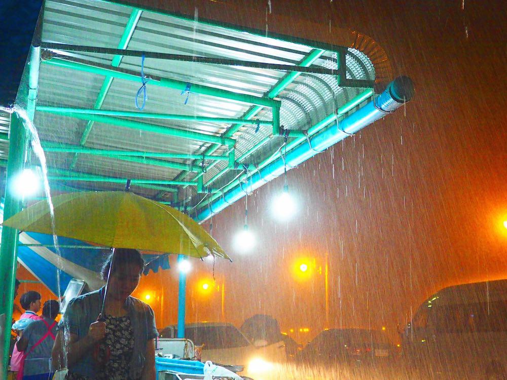Rain pours down outside a restaurant