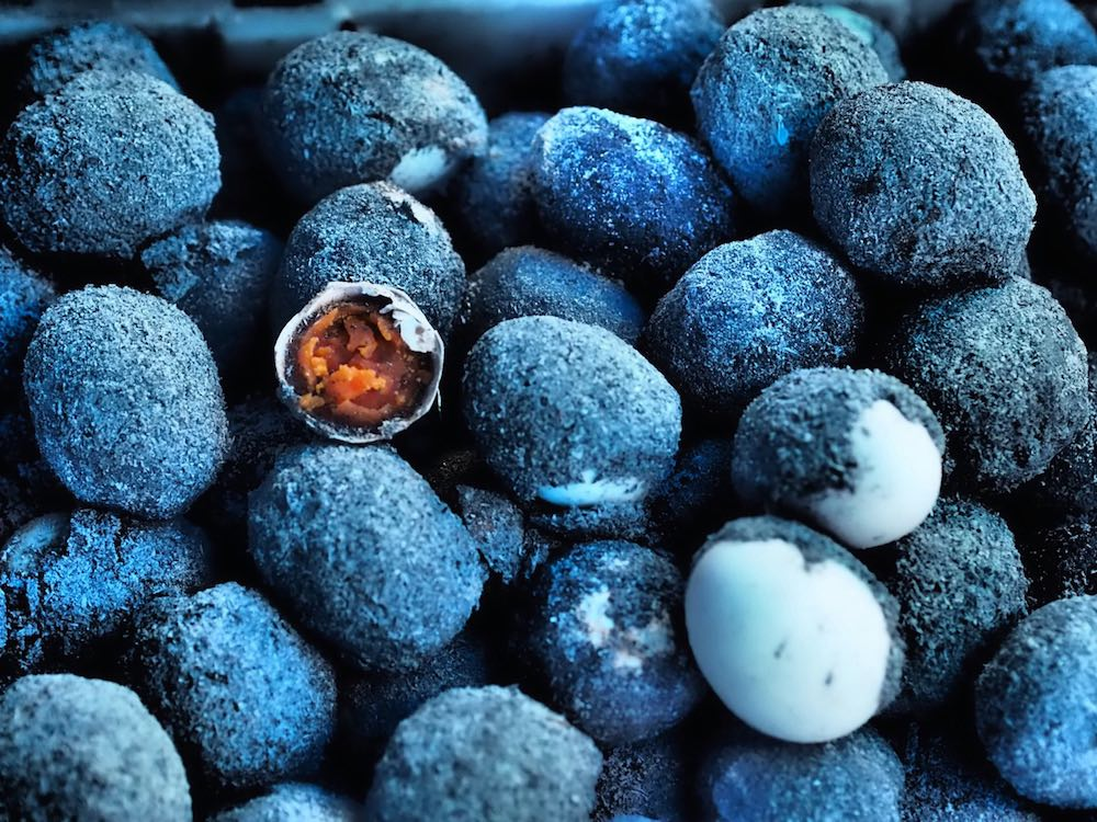 Aged blue-encrusted eggs