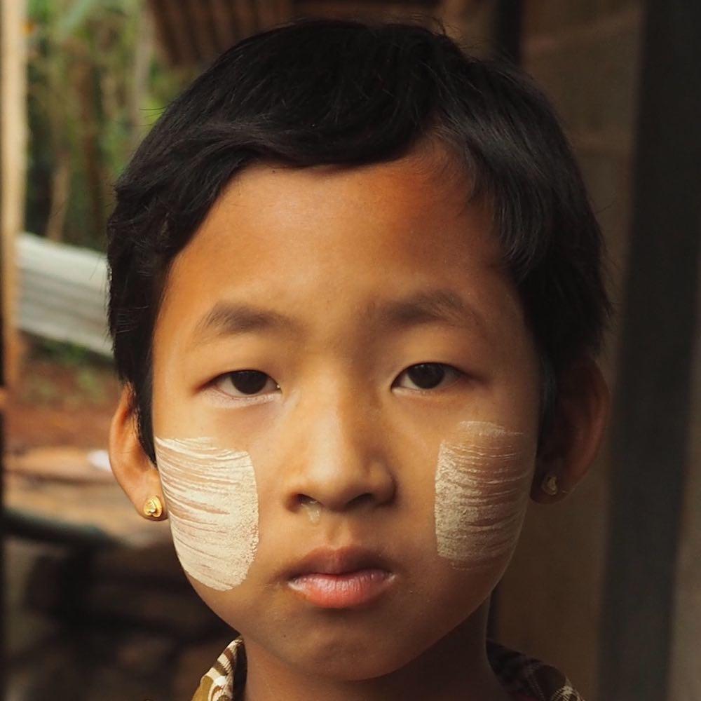 A young girl wearing thanaka