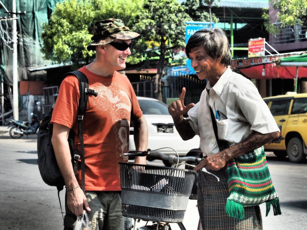 Man with longhi talks to Ian, Mandalay - Myanmar