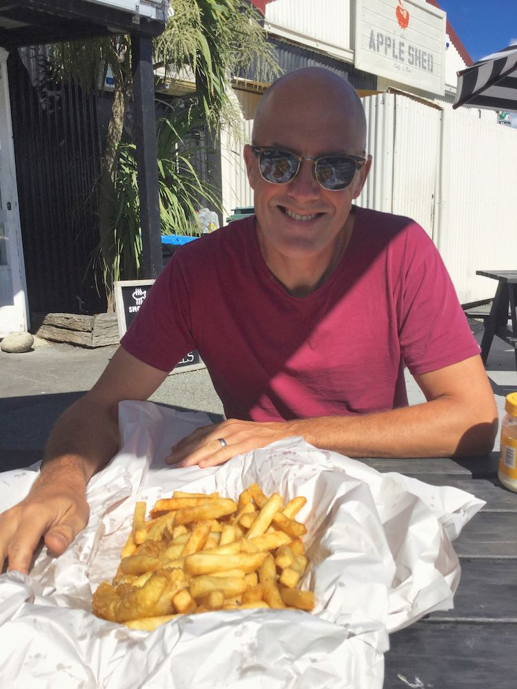Ian with fish and chips at Mapua Wharf