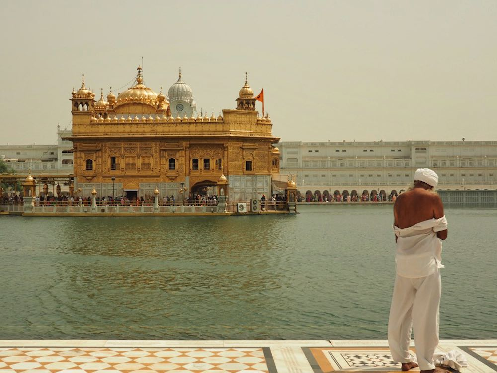 A pilgrim disrobes at the Golden Temple