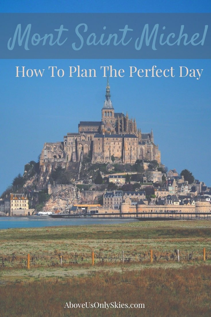 The island of Le Mont Saint-Michel (Mont St Michel) in Normandy, France is the stuff of legend and fairytales. We show you how to plan your trip there, easily done in a day-trip from Paris. And whether you choose to visit at high tide or low, the architecture is magnificent. #montstmichel #montsaintmichel #daytripsfromparis #europetravel #fairytalecastle