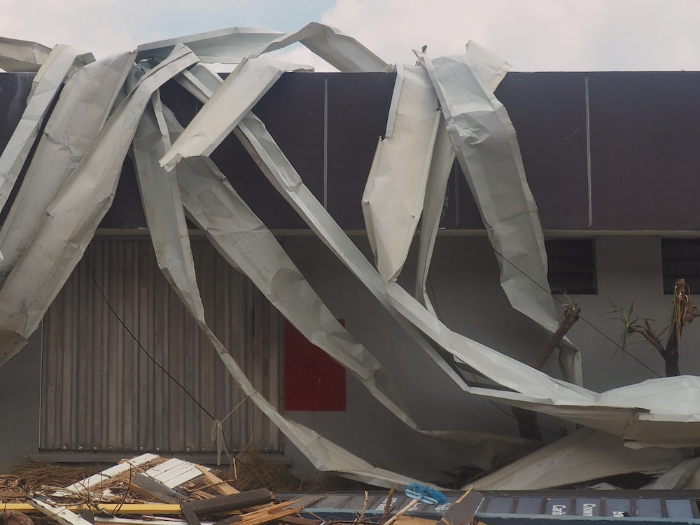 A store is enveloped with mangled metal