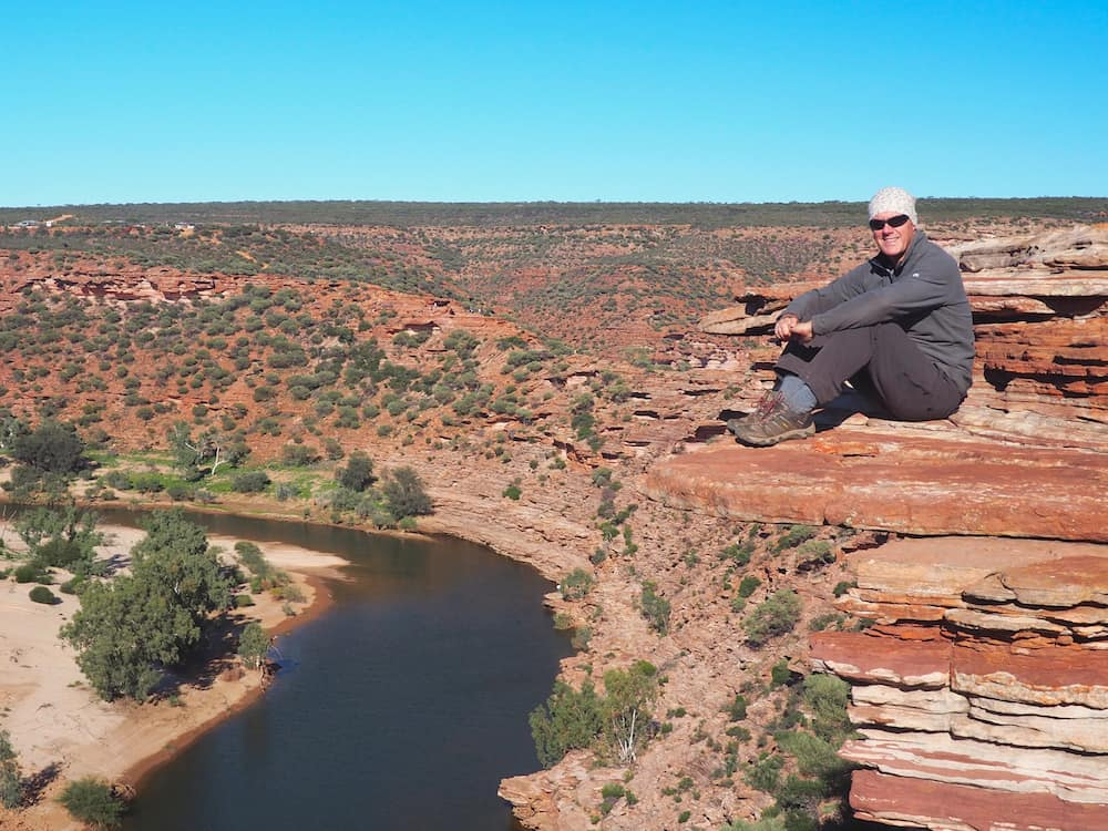 Ian sitting on a cliff at Kalbarri National Park