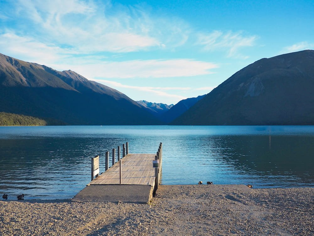 A wooden jetty stretches out on to Lake Rotoiti