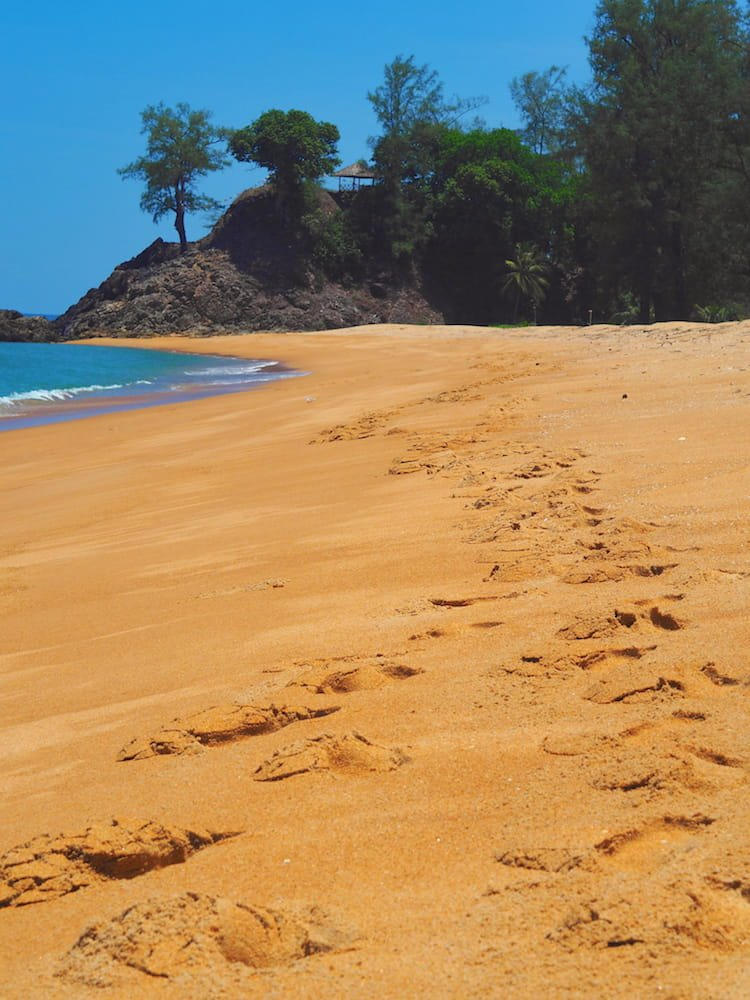 Footsteps on Golden Buddha Beach - Andaman Coast Itinerary