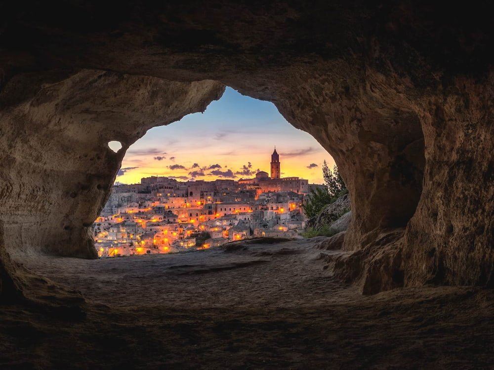 View of Matera at night from inside a cave