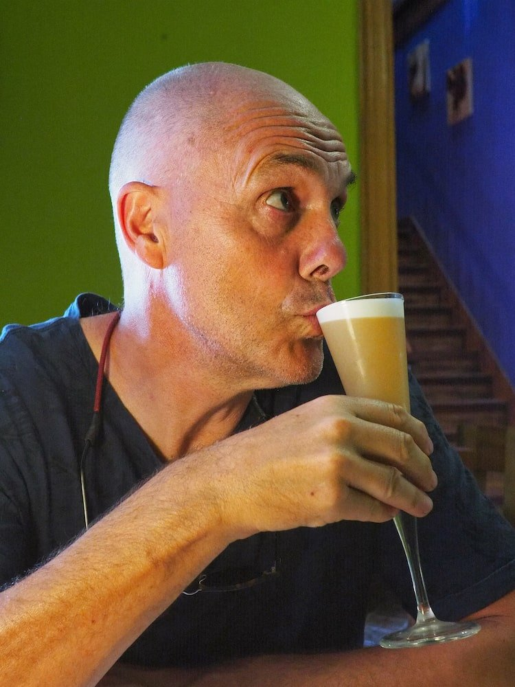 Ian with a black pepper pisco sour