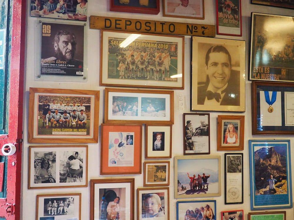 Wall decorated with photographs inside La Canta Rana
