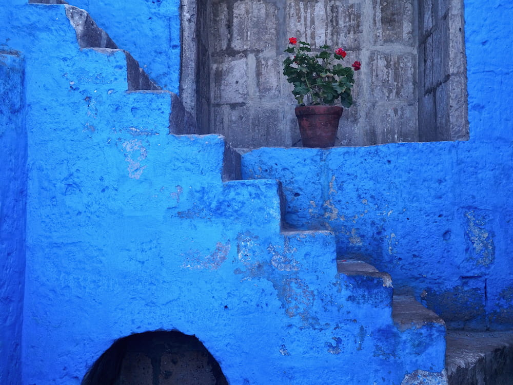 Blue steps on a blue wall