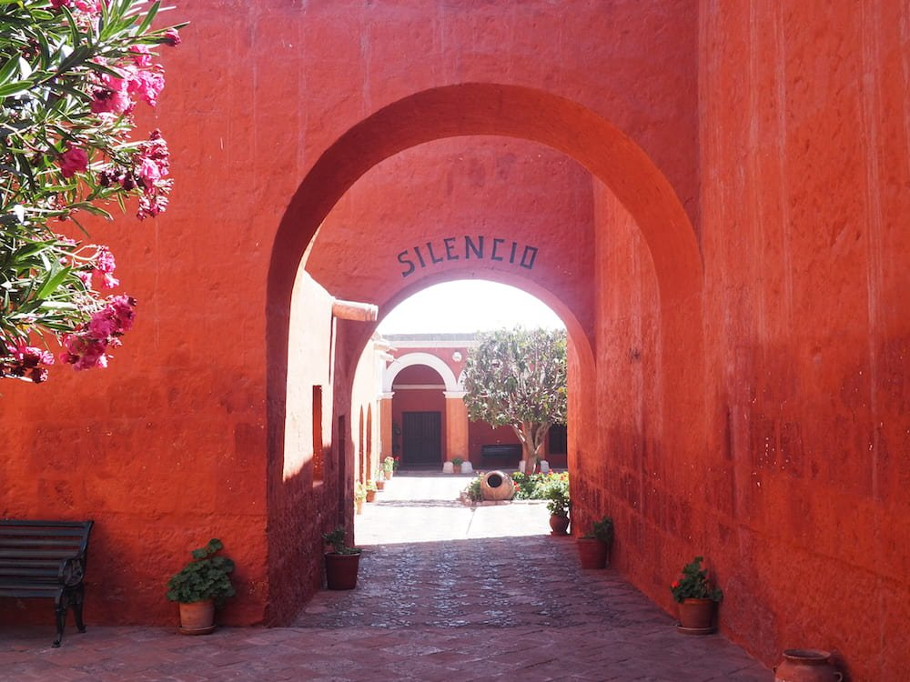 "A sign requests ""silence"" near the entrance to the monastery"