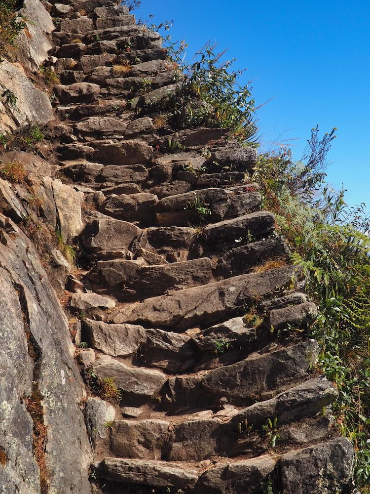 Very steep steps scale the side of Machu Picchu Mountain