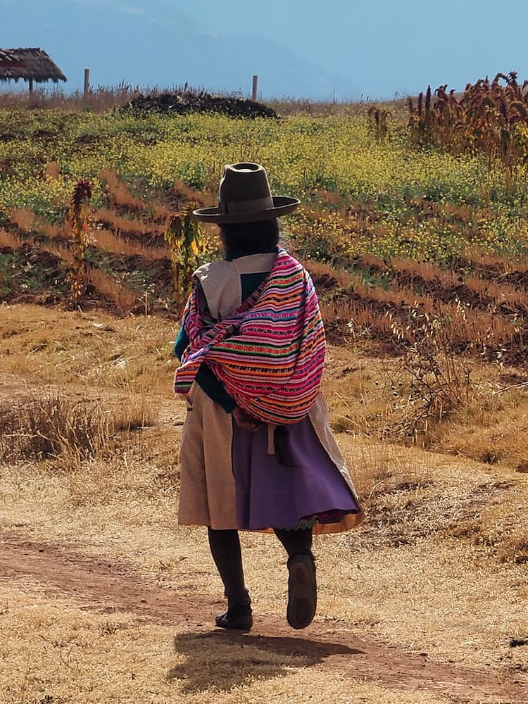 A woman in traditional dress - The Sacred Valley