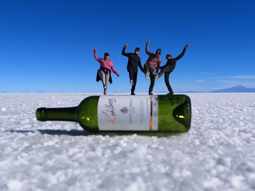 Perspective photo - four of us balaning on a wine bottle