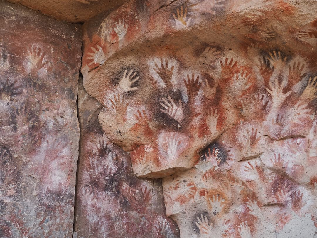 THE PREHISTORIC ROCK ART OF CUEVA DE LAS MANOS
