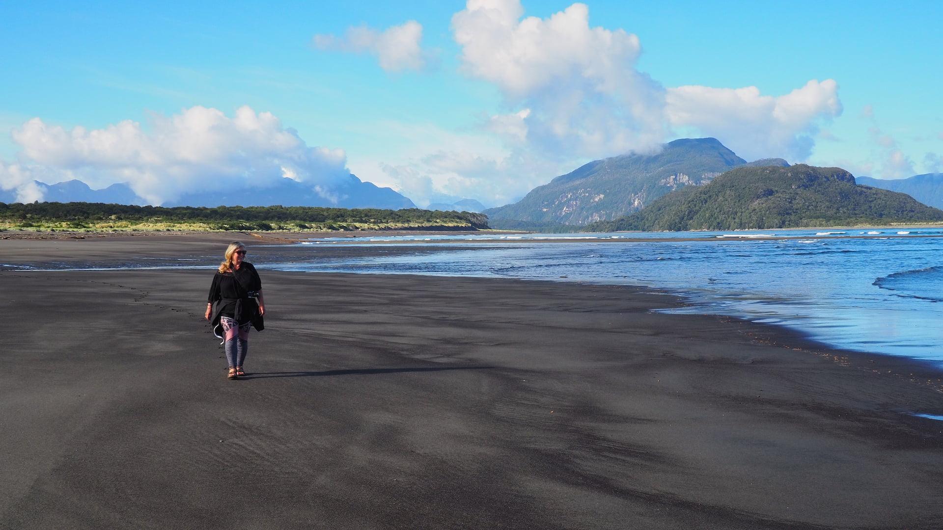 Nicky walking ocean side of the beach