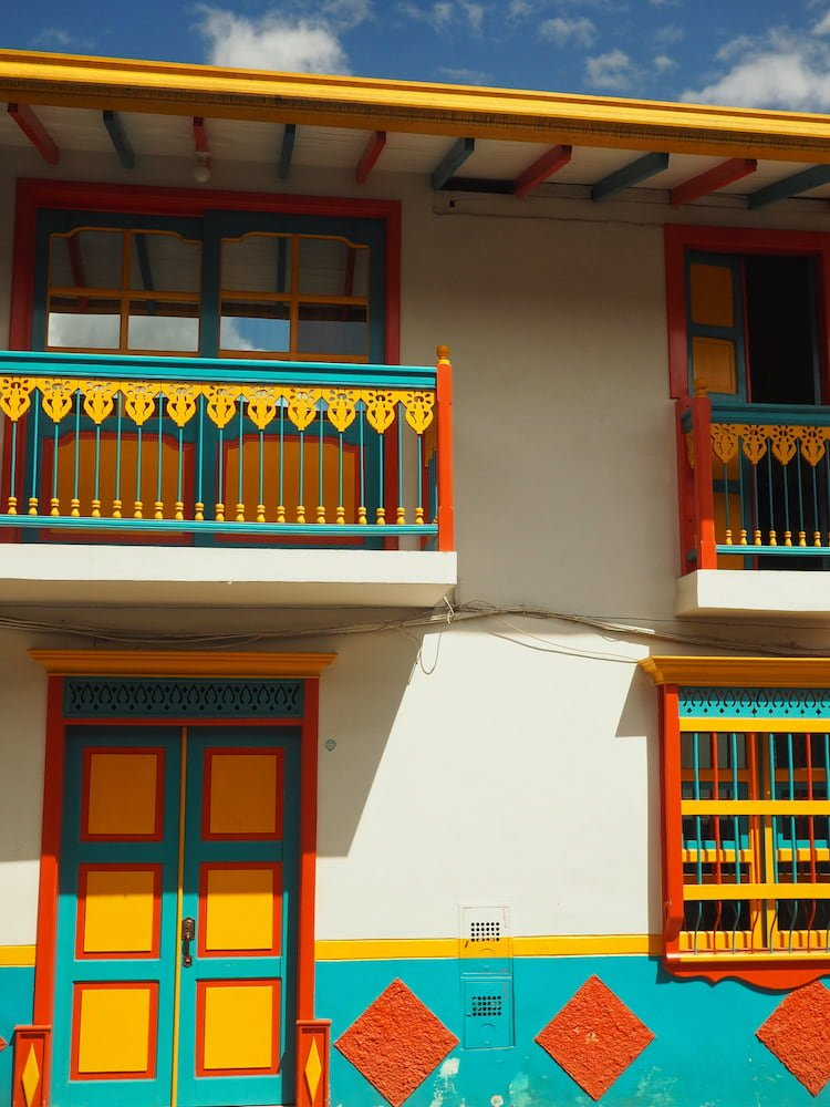 House painted in turquoise, red, yellow, white