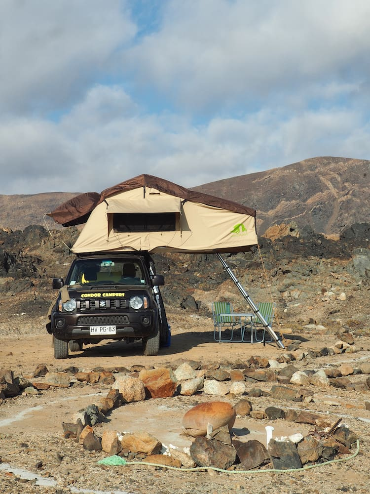 Rooftop tent opened out over jeep