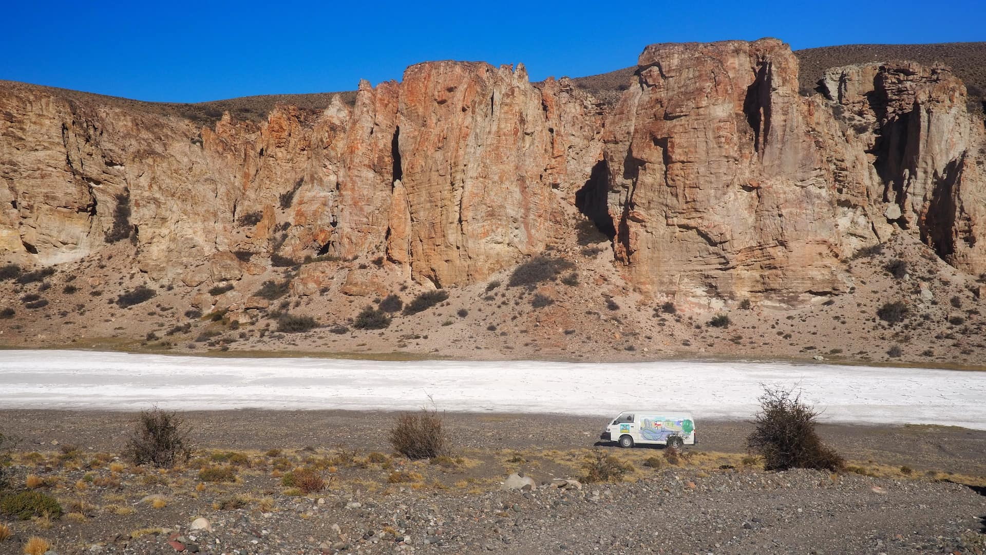 Camper van parked at the bottom of a canyon