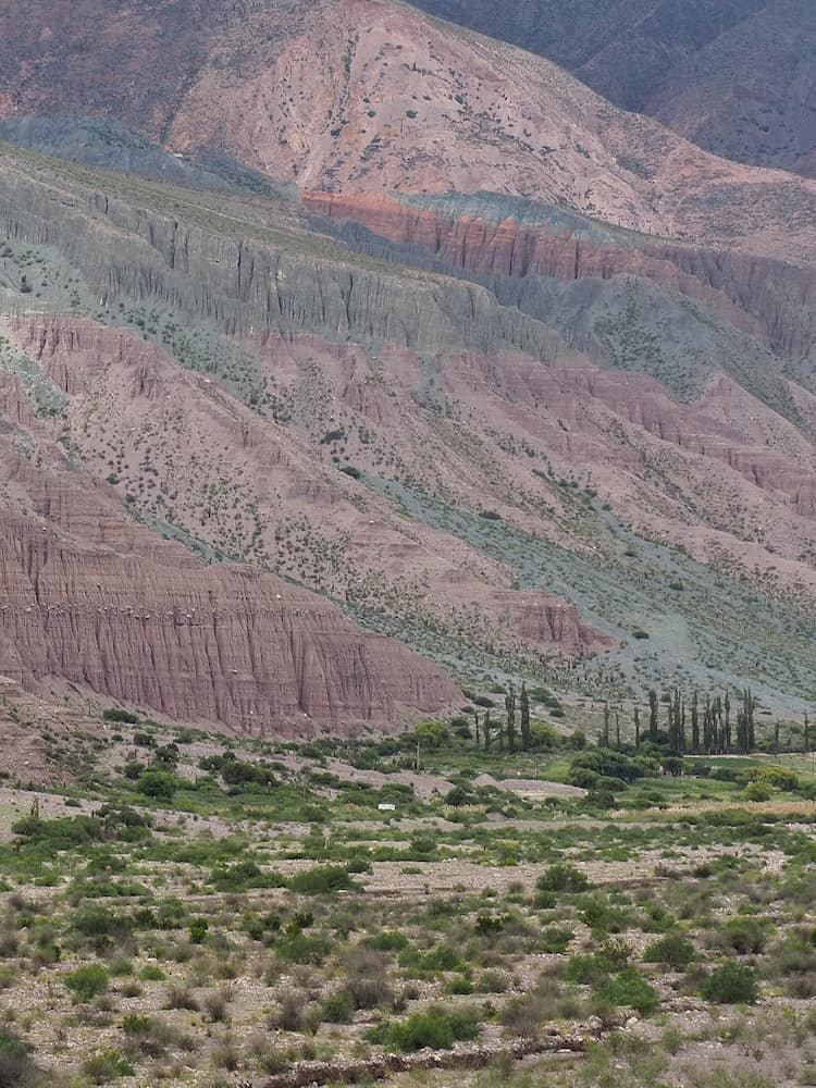 Green and red hills beside Purmamarca