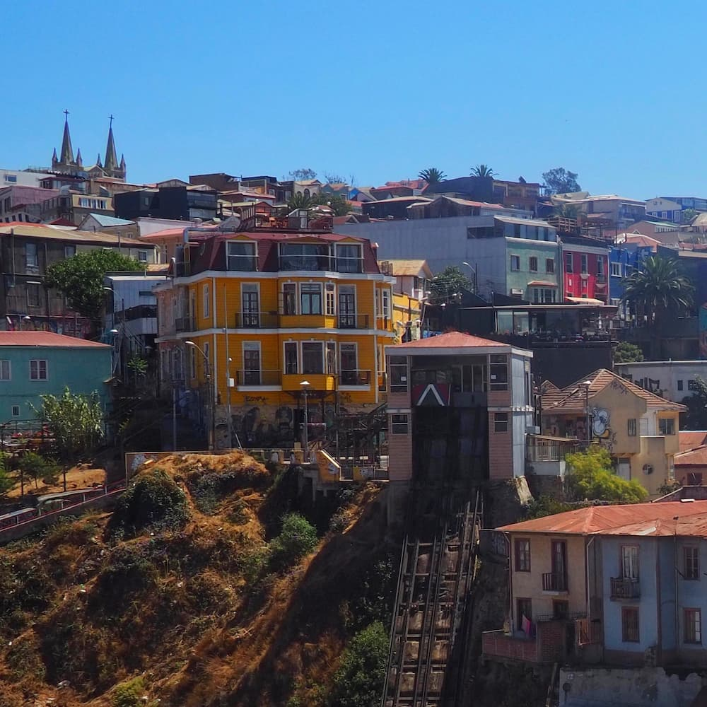 Coloured buildings on a hill with a funicular lift in the foreground