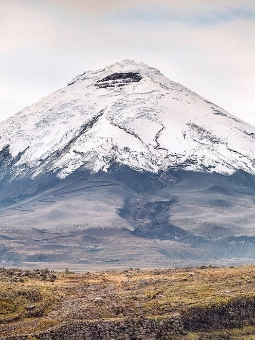 Conical-shaped volcano covered in snow