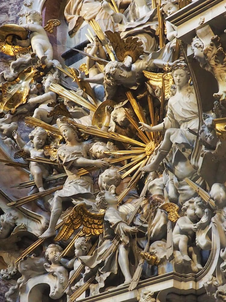 A cathedral sculpture including a variety of angel figures