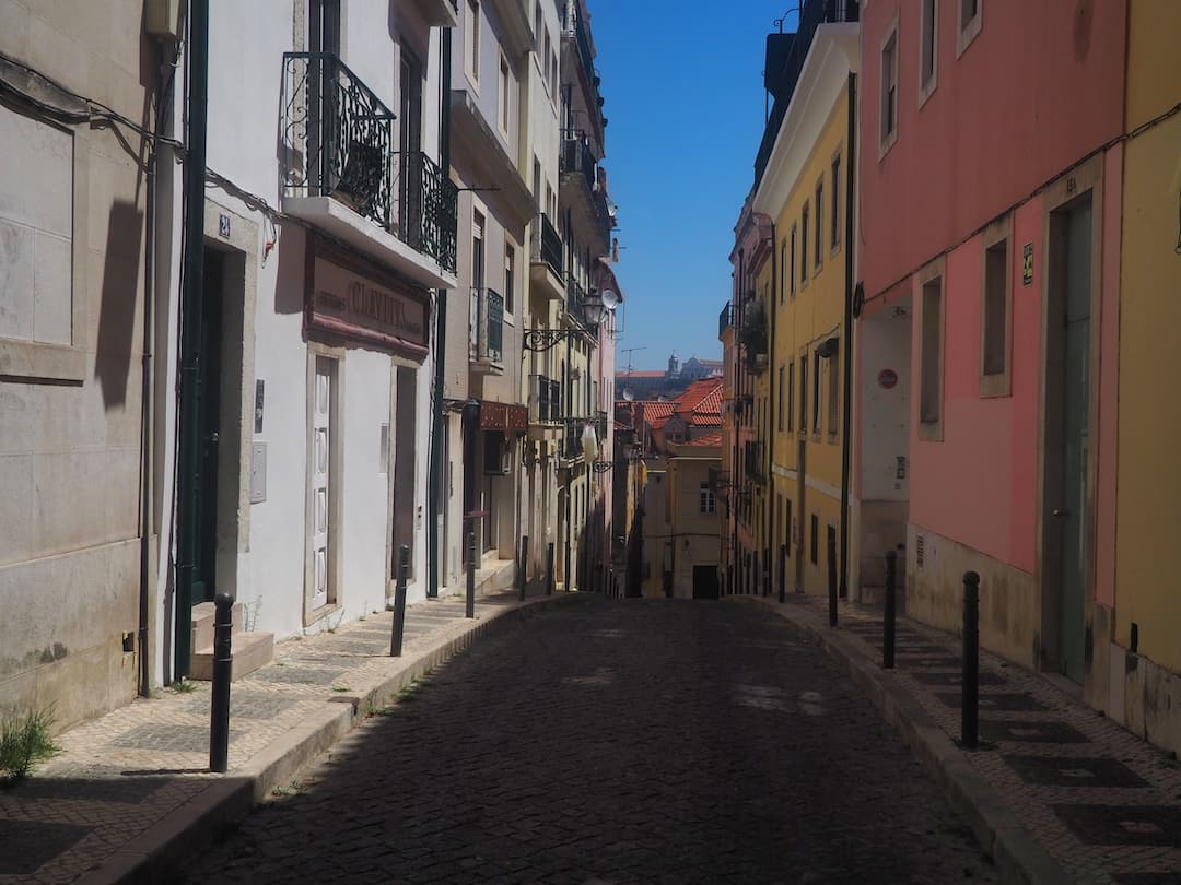 An empty street with yellow and red buildings