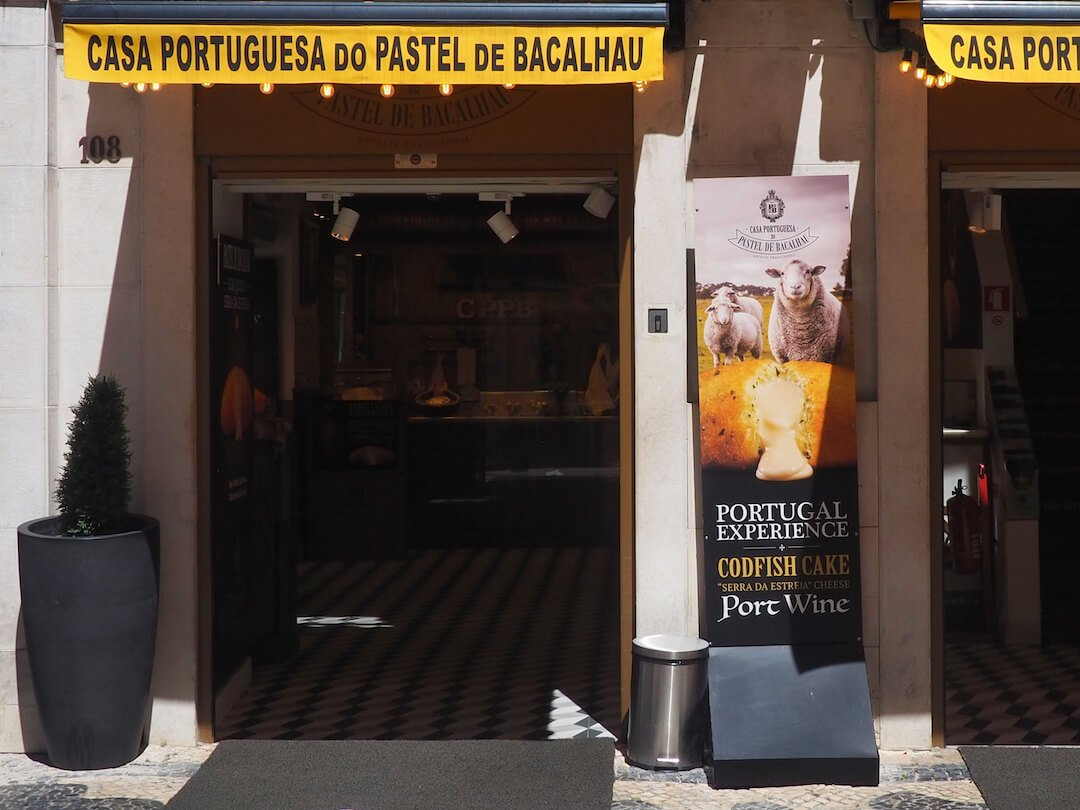 A shop entrance with a yellow banner running along the top