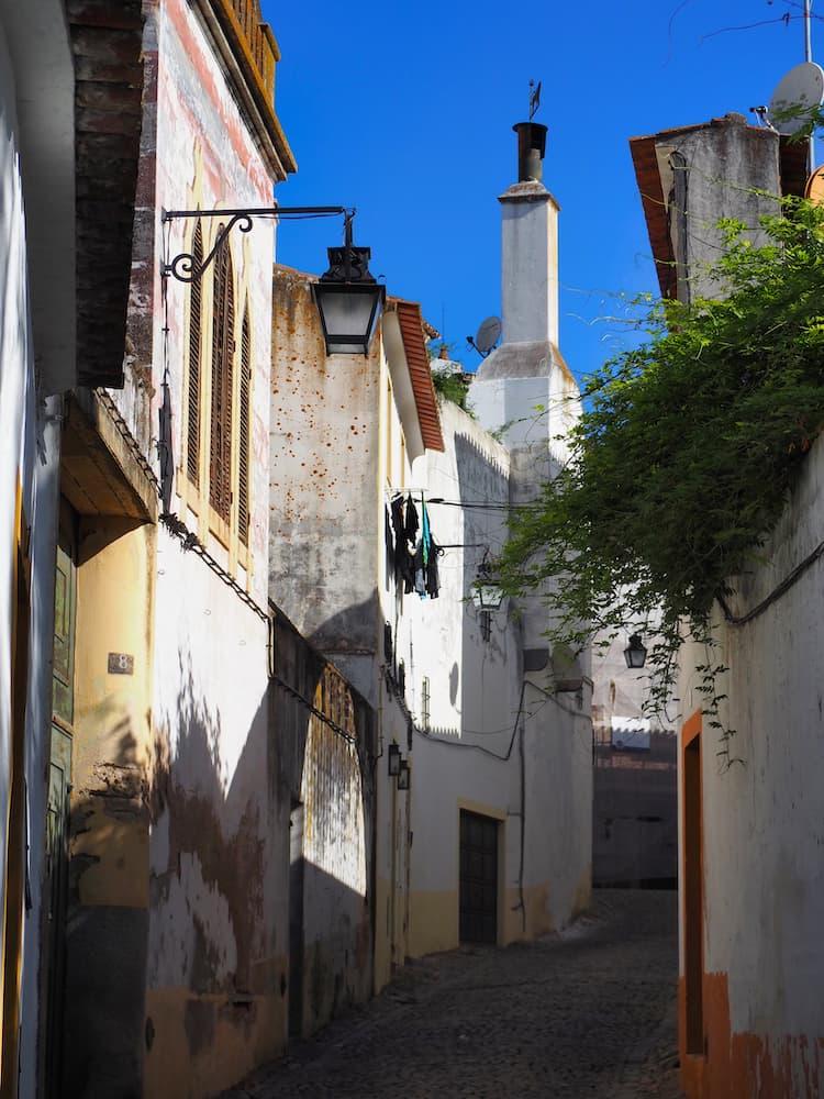 A narrow cobble-stoned street