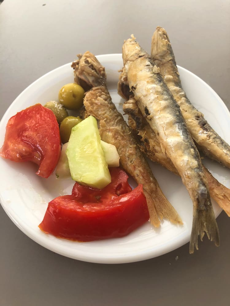 A plate of fried fish and salad