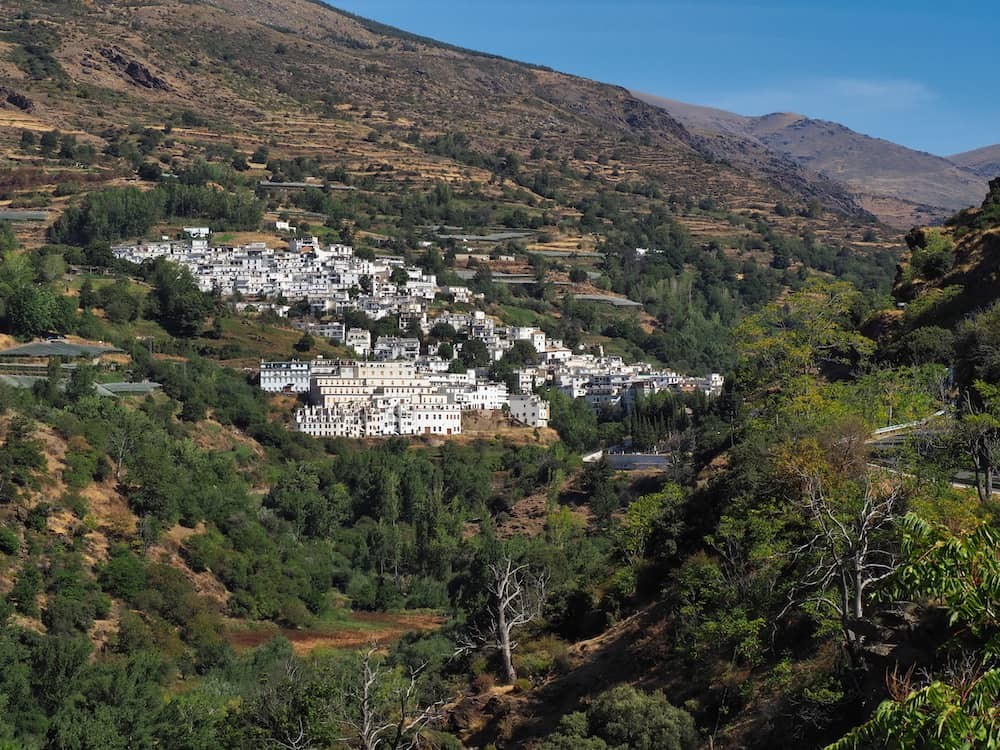 A white village on a green hillside