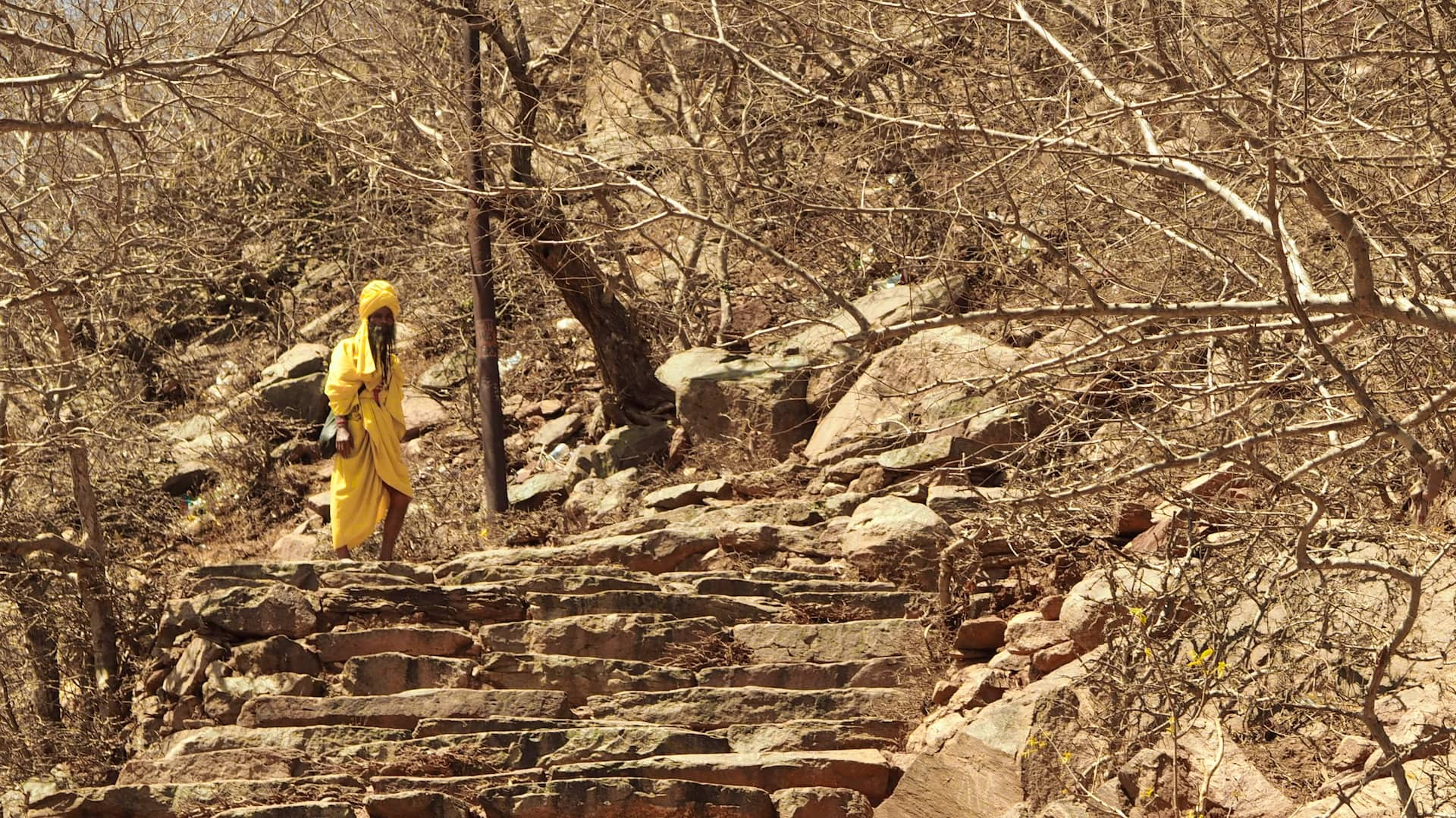 A man in yellow clothes stares at the camera