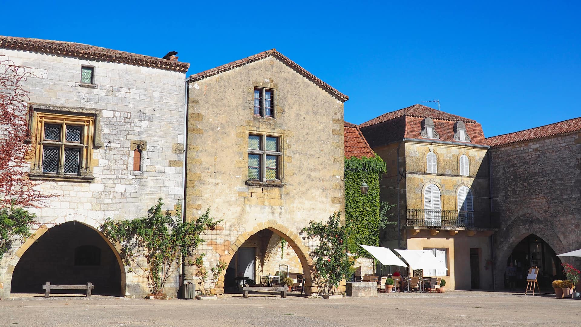 Stone buildings with three archways