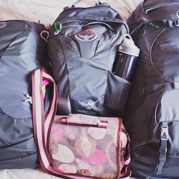 Three grey backpacks