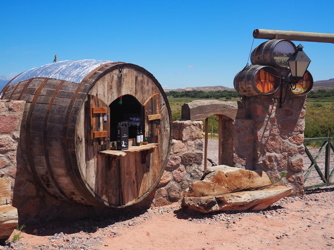 A small roadside stall made from a large wine barrel