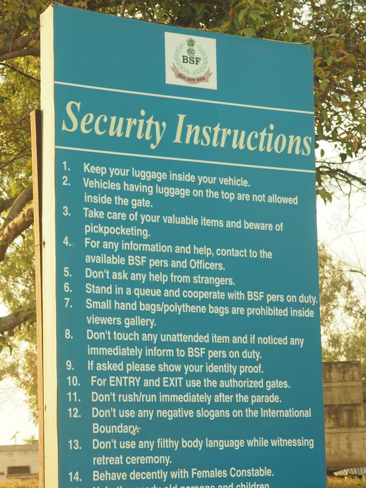 """A green sign entitled """"Security Instructions"""" with a list of items below it"""