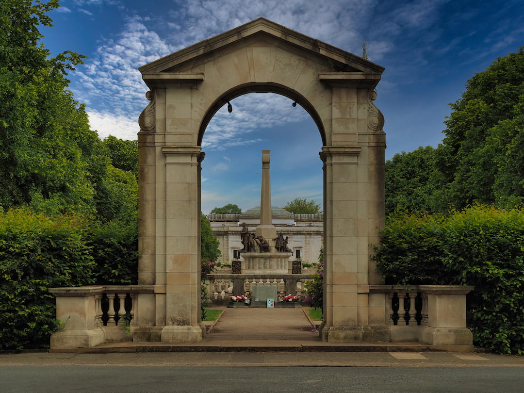 A store arch leads to a memorial garden
