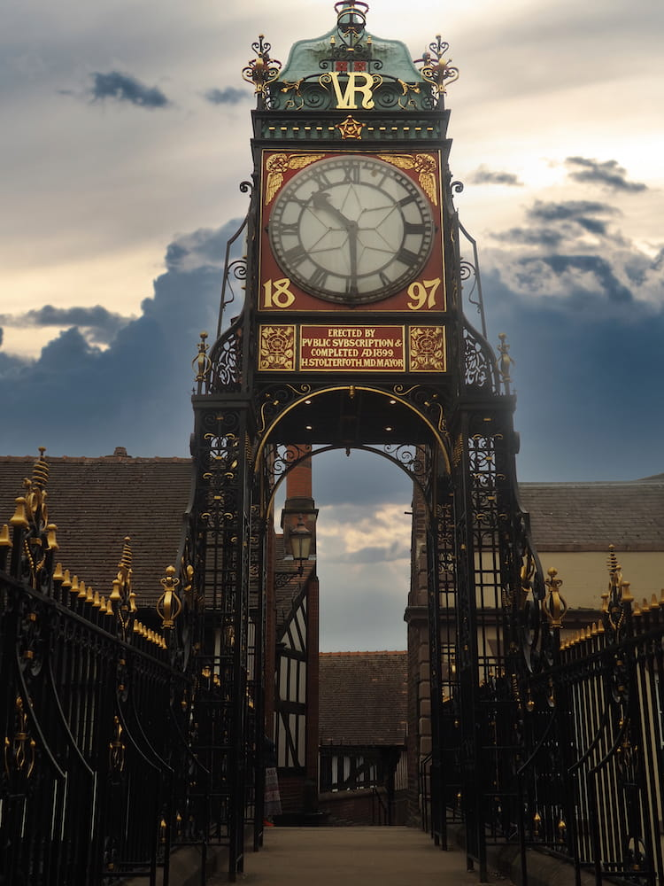 A bridge is topped with a clocktower