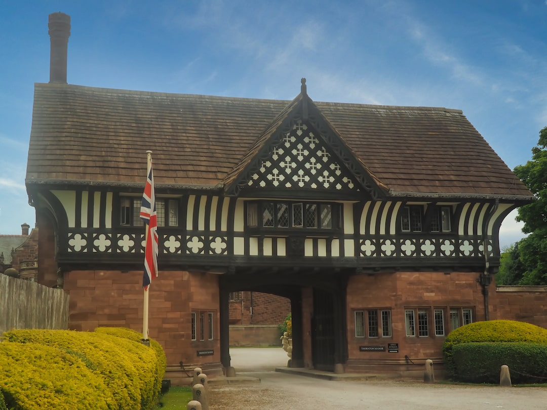 A building with a sandstone base and black-and-white half timbered first floor